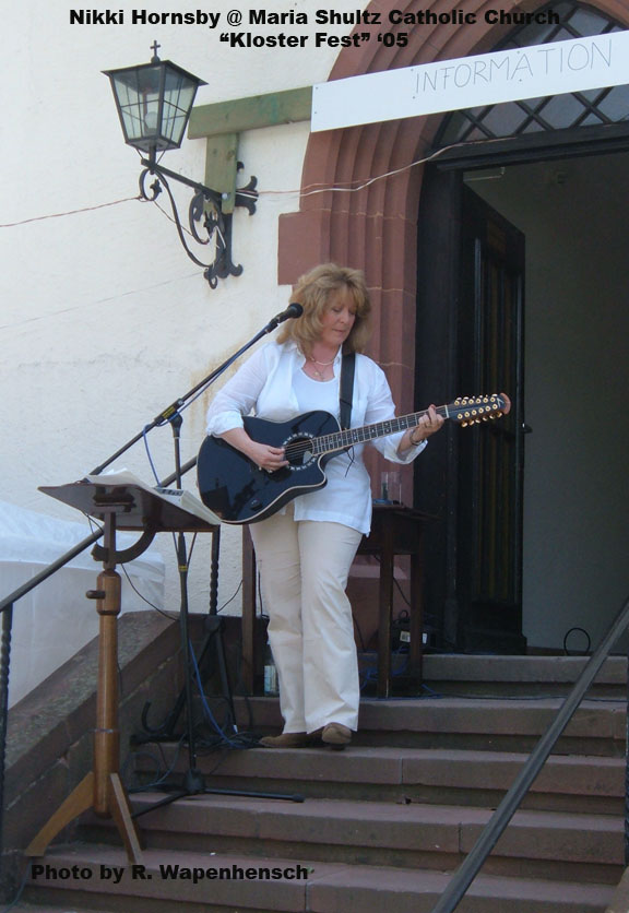Nikki Hornsby in Europe playing a city festival solo